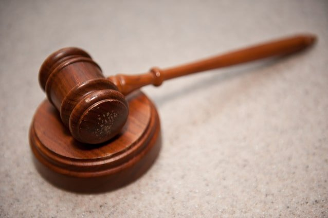Image of a wooden gavel for an article about Online Reverse Auction Solutions and Optimizations.