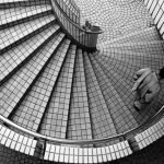 Image of a man walking up steps for an article about What is Your Procurement Spend Analysis Process?